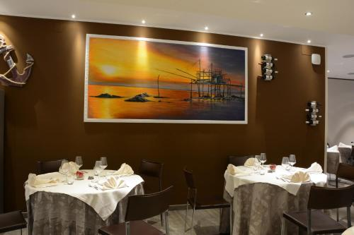 A restaurant or other place to eat at Kiara Residence