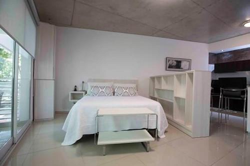 A bed or beds in a room at Luxury La Abadía