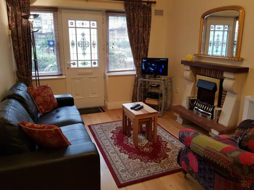 A seating area at Halfpenny Bridge Holiday Homes - Garden