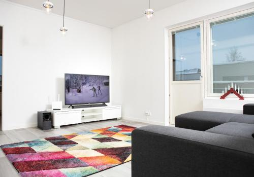 A television and/or entertainment center at Riverside Residences