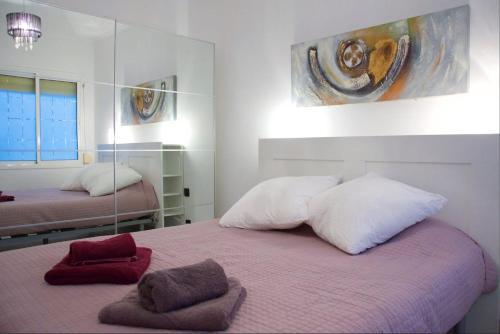 Kama o mga kama sa kuwarto sa Apartment Sagrera