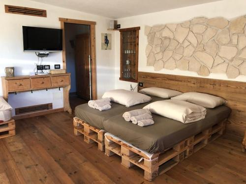 A bed or beds in a room at Appartamenti La Pratolina
