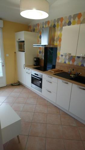 A kitchen or kitchenette at l'ourson, 5 La Vionnière