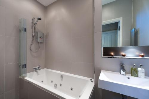 A bathroom at Livingstone Place Apartment