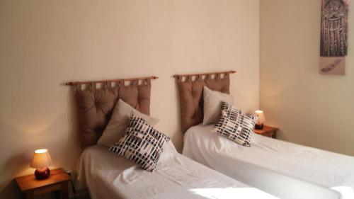 Un ou plusieurs lits dans un hébergement de l'établissement Domaine du Barvy