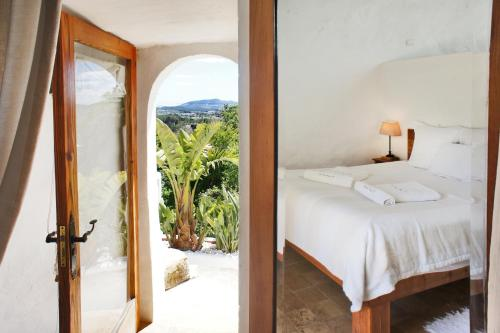 Letto o letti in una camera di Can Quince de Balafia