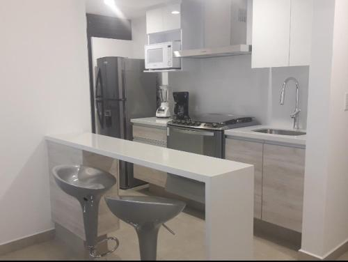 A kitchen or kitchenette at Guadalupe Inn CDMX, NUEVO ESTRENA