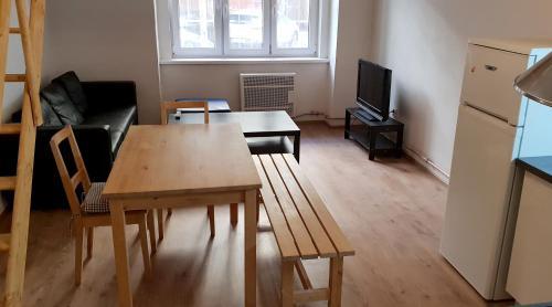 Телевизор и/или развлекательный центр в New cozy apartment
