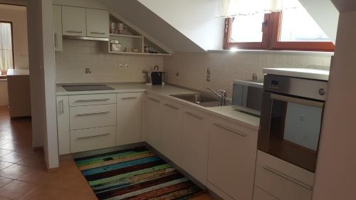 Kuhinja oz. manjša kuhinja v nastanitvi Apartment Stella