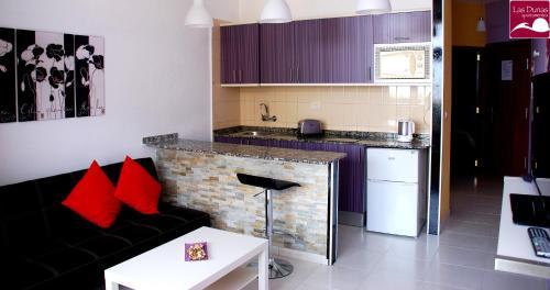 A kitchen or kitchenette at Apartamentos las Dunas