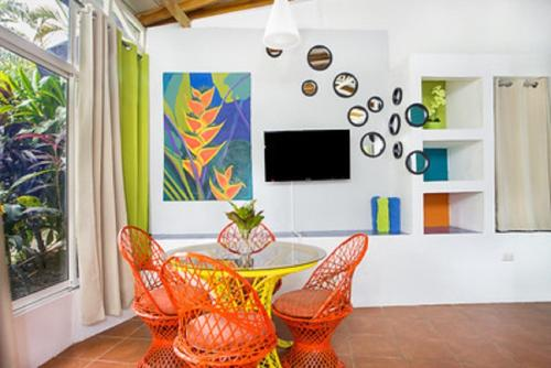 A television and/or entertainment center at Tico Tico Villas - Adult Only