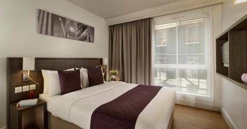 Postel nebo postele na pokoji v ubytování Citadines Trafalgar Square