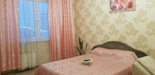 A bed or beds in a room at Apartment at Krylova