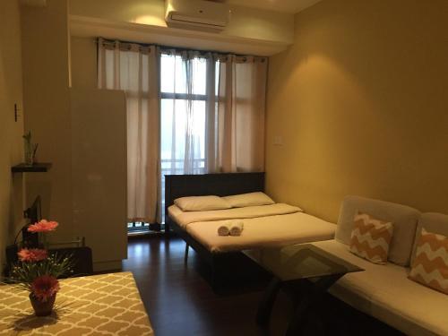 Cama o camas de una habitación en Ya keyes @ Knightsbridge Residences