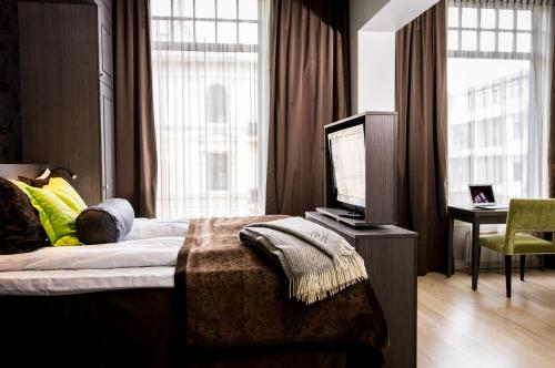 A bed or beds in a room at Frogner House Apartments - Skovveien 8
