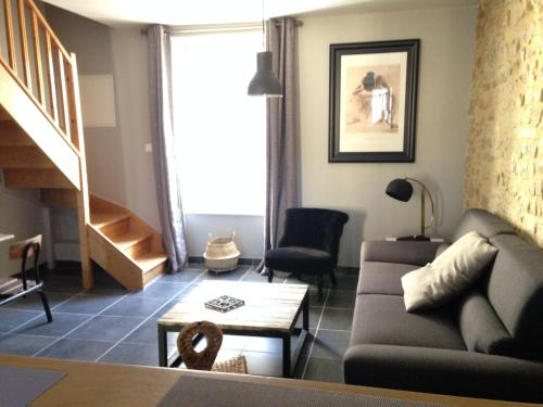 A seating area at Appartement Camélia Bayeux centre-ville