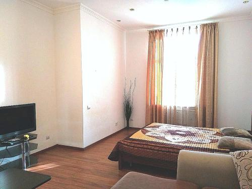 Кровать или кровати в номере W Apartament Suvorova 15