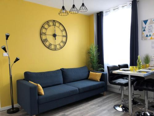 Coin salon dans l'établissement Apart'Moment Saint-Omer Centre