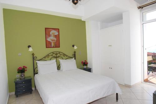 A bed or beds in a room at Molyvos Queen Apartments
