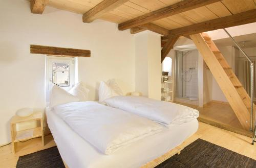 Ein Bett oder Betten in einem Zimmer der Unterkunft Auberge du Mouton