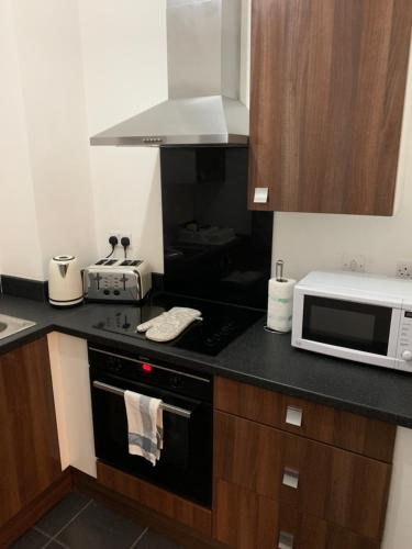 A kitchen or kitchenette at 1 Mint Drive