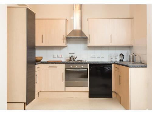 Küche/Küchenzeile in der Unterkunft Modern, light and spacious city centre pad for 4