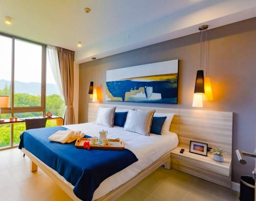A bed or beds in a room at Ocean Stone Phuket by Holy Cow 7