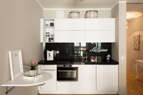 Küche/Küchenzeile in der Unterkunft ELOUISA sweet HOME APPARTEMENTS