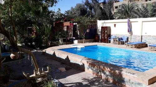The swimming pool at or near Villa Bahri Luxor Apartment