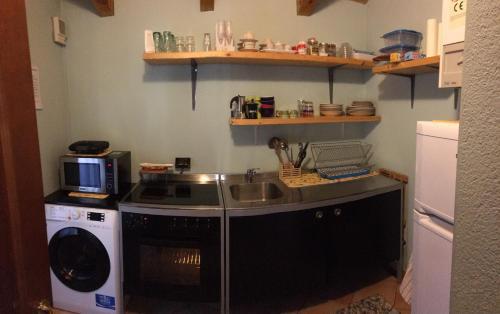 A kitchen or kitchenette at Maison CAVALLO BIANCO