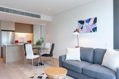 A seating area at Luxury Apartment / / Moments to Lane Cove Village