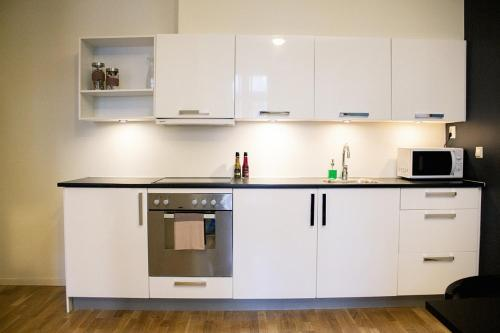 A kitchen or kitchenette at Forenom Serviced Apartments Oslo Royal Park