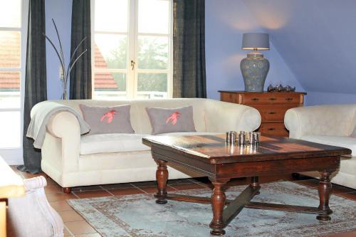 A seating area at Ferienwohnung im Blauen Haus