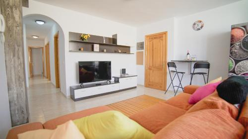 A television and/or entertainment center at AR Home - New Lovely 3 bedroom apartment in Telde