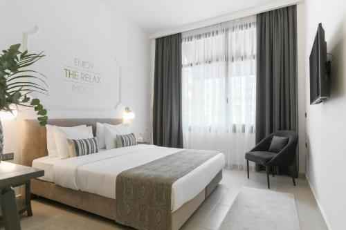 A bed or beds in a room at The Mood Luxury Rooms