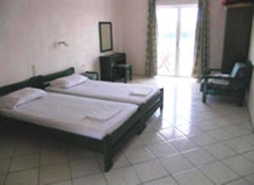 Ένα ή περισσότερα κρεβάτια σε δωμάτιο στο Kolios Beach Seaview Studios