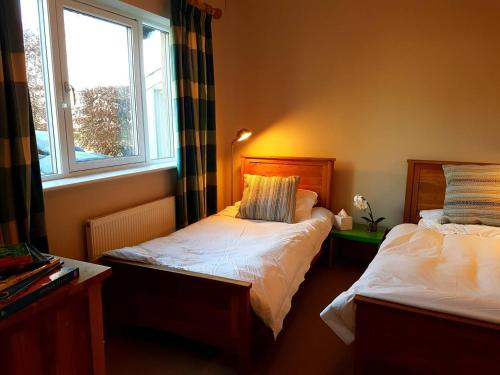 A bed or beds in a room at The Annexe - Itchen Stoke Manor