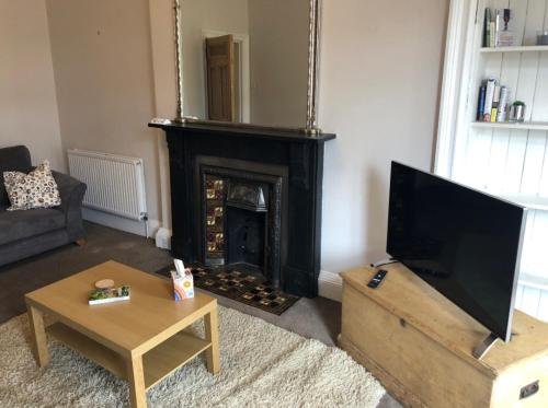 A television and/or entertainment centre at Edinburgh City Centre Traditional Apartment