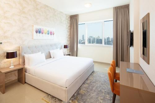 A bed or beds in a room at Barceló Residences Dubai Marina