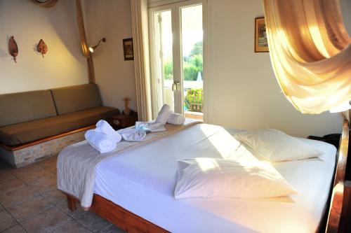 Ένα ή περισσότερα κρεβάτια σε δωμάτιο στο Alkyon Apartments & Villas Hotel
