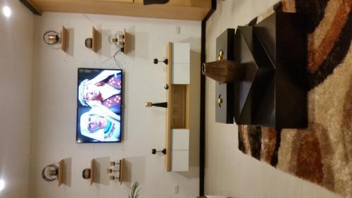 A television and/or entertainment center at Condominio la Victoria