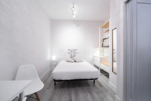 Postel nebo postele na pokoji v ubytování Apartamento cerca de la estación de Atocha