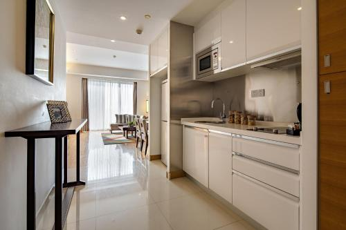 A kitchen or kitchenette at Shama Heda Serviced Apartment
