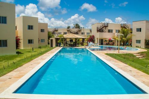 The swimming pool at or near Paraiso de Maracajau 4