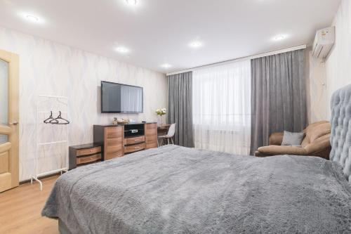 Кровать или кровати в номере На-Сутки на Р. Удриса 9