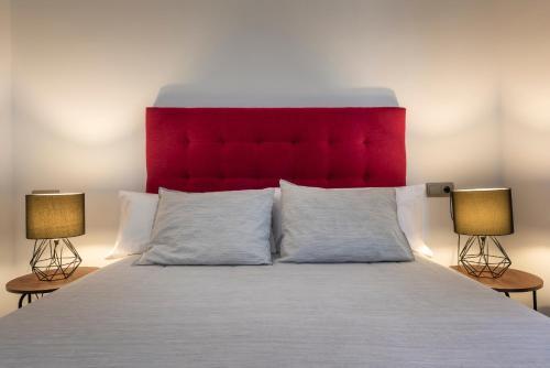 A bed or beds in a room at Apartamentos Adriano