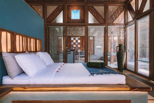 A bed or beds in a room at Samsara Villas