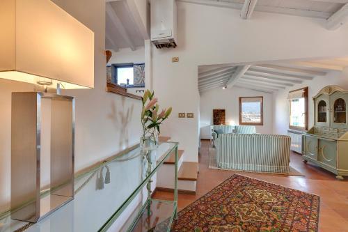 TV/Unterhaltungsangebot in der Unterkunft Garbo charm, Case Galante Apartments in Florence