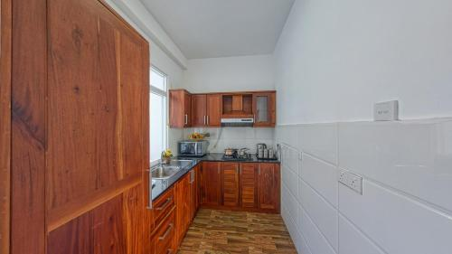 A kitchen or kitchenette at Ocean Breeze Apartment Colombo