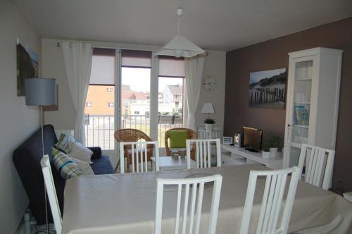 Ein Sitzbereich in der Unterkunft Appartement Vivacances côte d'Opale (Ste-Cécile)